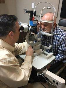 dr august wallace eye exam with patient 4