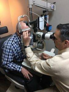 dr august wallace eye exam with patient 6