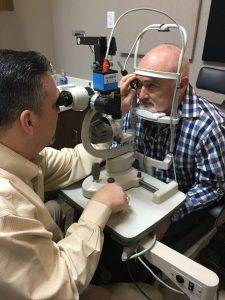 Dr August Wallace Eye Examination with patient in Longview, TX
